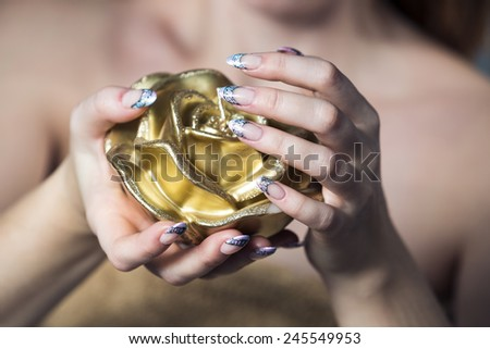 close-up of female hands with painted nail polish on the background  flowers - stock photo