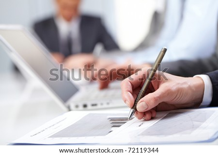 Close-up of female hands working with document - stock photo
