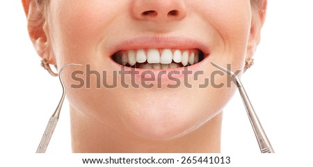 Close up of female mouth with white teeth - stock photo