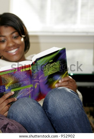 close-up of female teen reading book - stock photo