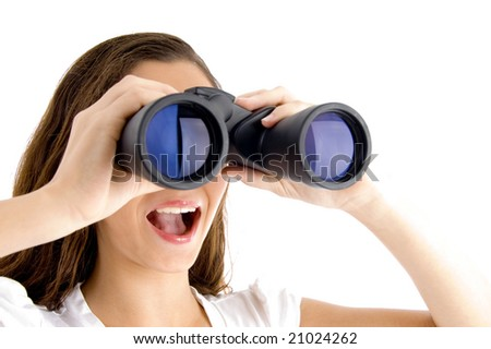 close up of female watching through binocular on an isolated white background - stock photo