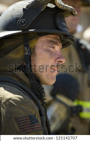 Close-up of fire fighter at work - stock photo