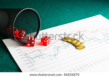 Close up of five dice and coin on  financial chart - stock photo
