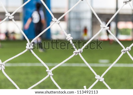 Close up of football or soccer goal net in the indoor soccer pitch - stock photo