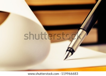 Close-up of fountain pen and book - stock photo