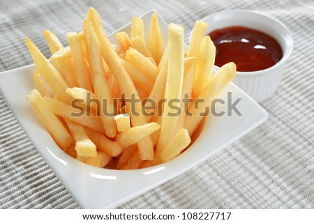 close-up of French Fries on cup and Ketchup - stock photo