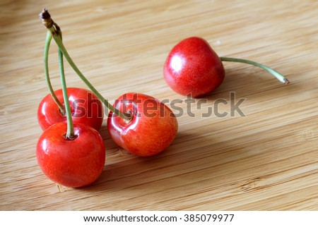 Close-up of fresh cherries in a bamboo bowl. - stock photo