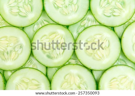 Close up of fresh cucumber slices background - stock photo