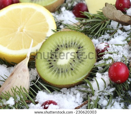 Close up of fresh green kiwi slice with other fruits - stock photo