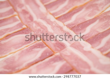 Close up of fresh or uncooked bacon or pork belly for barbecue or grill food background - stock photo