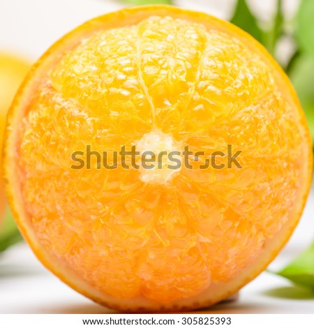 close up of fresh orange on the white background - stock photo