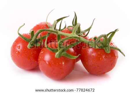 Close up of fresh red tomatoes on a white background - stock photo