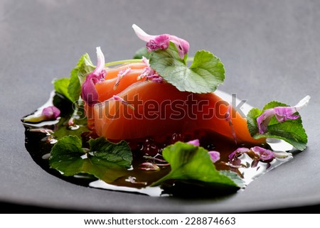 Close up of fresh salmon sashimi with fresh spices in the wok - stock photo