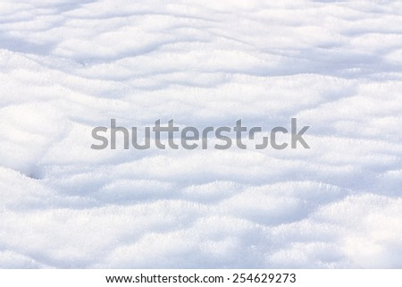 Close up of frozen waves of white snow - stock photo
