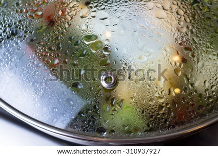 Close-up of frying pan lid with water drops - stock photo