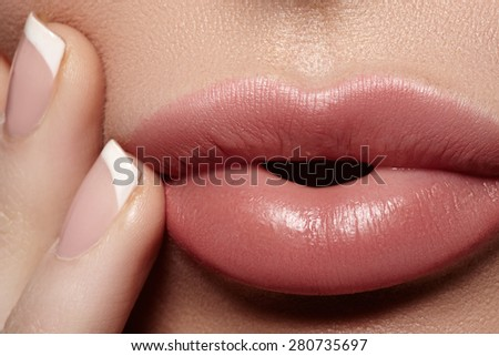 Close-up of full woman's lips with natural light makeup. Beauty macro sexy female mouth and french manicure on nails. Naturel tender look - stock photo