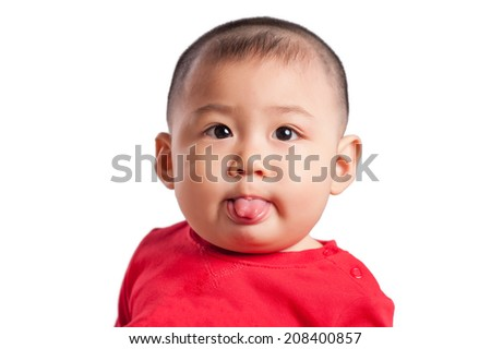 Close up of funny baby with tongue sticking out - stock photo