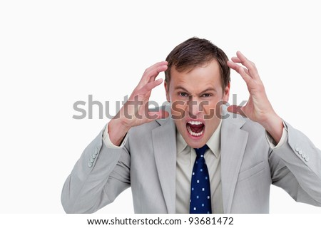 Close up of furious yelling businessman against a white background - stock photo