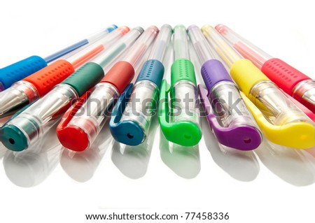 Close up of gel pen selection over reflective white. - stock photo