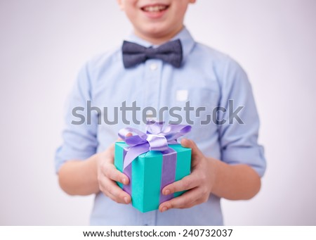 Close-up of gift box on hands of a boy - stock photo