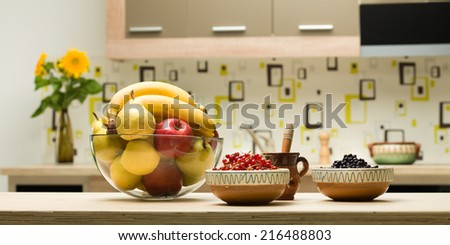 close-up of glass bowl with fruits on kitchen countertop - stock photo