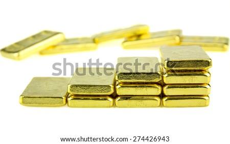 Close up of gold bar isolated on white background - stock photo