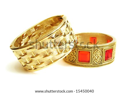 Close-up of golden bracelets isolated on white background - stock photo