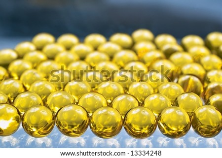 Close up of golden colored oil capsules - stock photo
