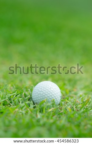 Close up of golf ball on Green grass - stock photo