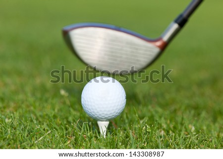 close-up of golf club with ball on tee - stock photo
