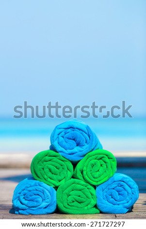 Close up of green and blue towels background the sea - stock photo