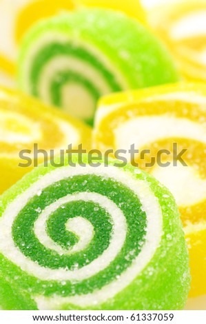 Close-up of green and yellow candy, full frame. - stock photo