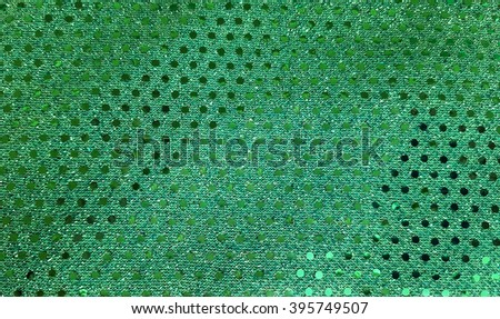 close up of green fabric with shiny sequins - stock photo