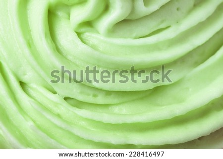 Close up of green icing on a cup cake - stock photo