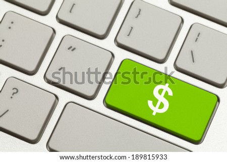 Close Up of Green Money Key with Cash Symbol on a Keyboard. - stock photo