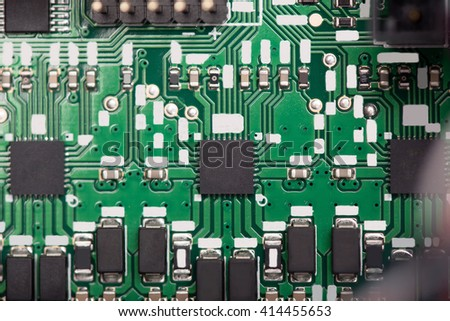 Close up of green system board with microchips  - stock photo