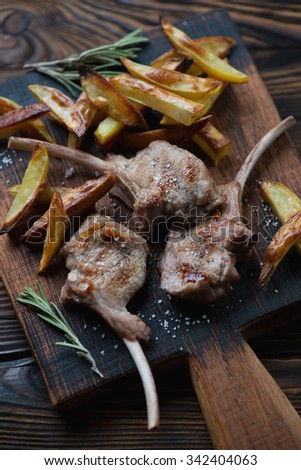 Close-up of grilled bobby veal rack steaks with french fries, selective focus - stock photo