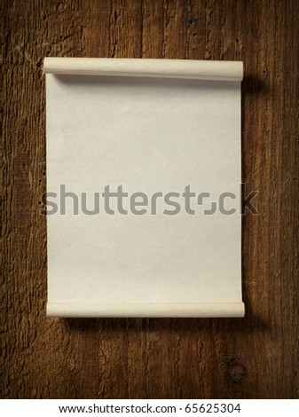 close up of grunge note paper on wooden background - stock photo