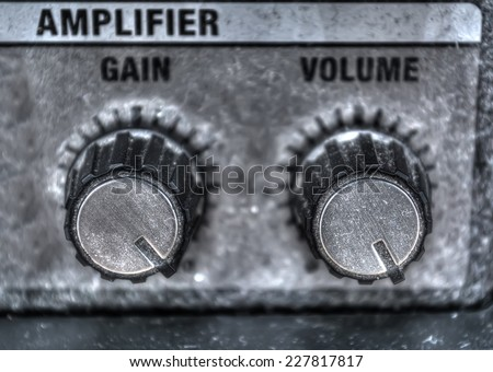close up of guitar amplifier knobs.  heavy processed for hdr tone mapping effect - stock photo