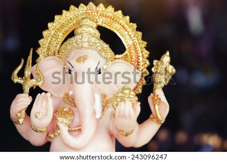 Close-up of hand crafted clay idol of Hindu god Ganesha - Lord of good omen - stock photo