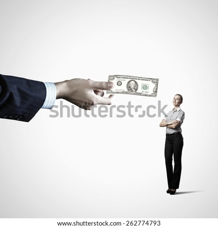 Close up of hand giving money to businesswoman - stock photo