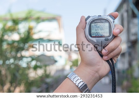 Close Up Of Hand Holding Digital chronometer - stock photo