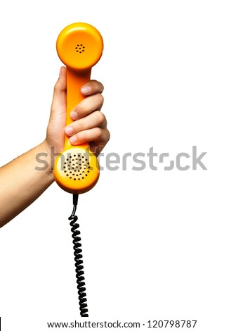 Close Up Of Hand Holding Telephone against a white background - stock photo