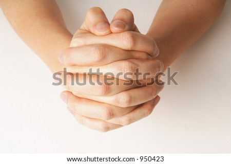 close up of hand praying - stock photo