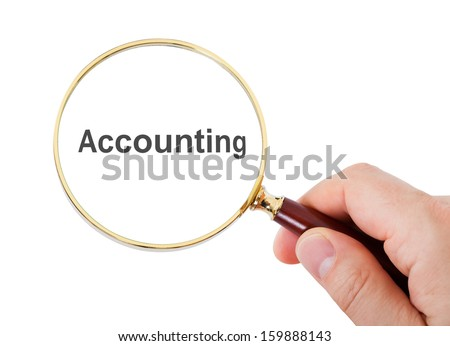 Close-up Of Hand Showing Accounting Word Through Magnifying Glass Over White Background - stock photo