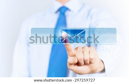 Close up of hand touching icon with finger - stock photo