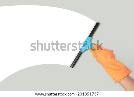 close up of hand with window cleaning tool - stock photo
