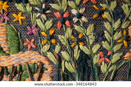 Close up of hand woven floral tapestry - stock photo