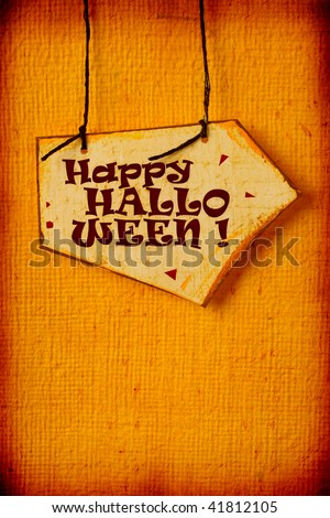 Close up of handmade paper tag with HALLOWEEN - stock photo