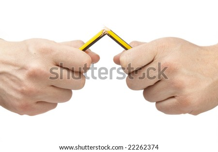 close up of hands and broken pencil on white background with clipping path - stock photo